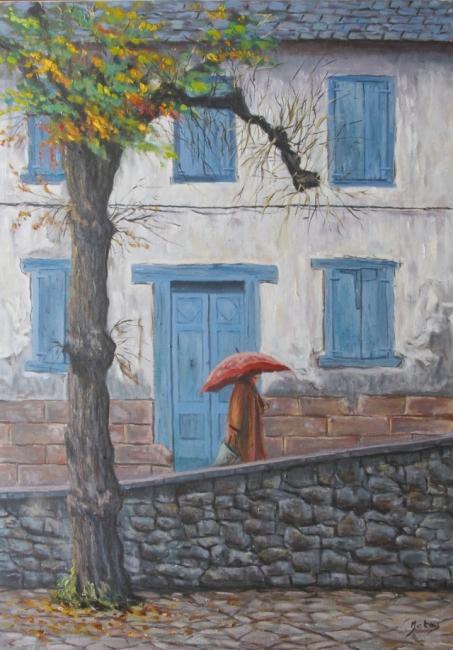 Vella façana sota pluya