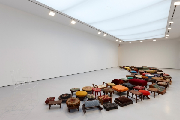 Valeska Soares, Un-rest, 2010, 128 foot stools, 1 glass chair, 2 ft. 10 in. x 39 ft. 4 in. x 14 ft. 6 in.; Chair dimensions: 33 x 18 x 20 in. Courtesy of the Artist